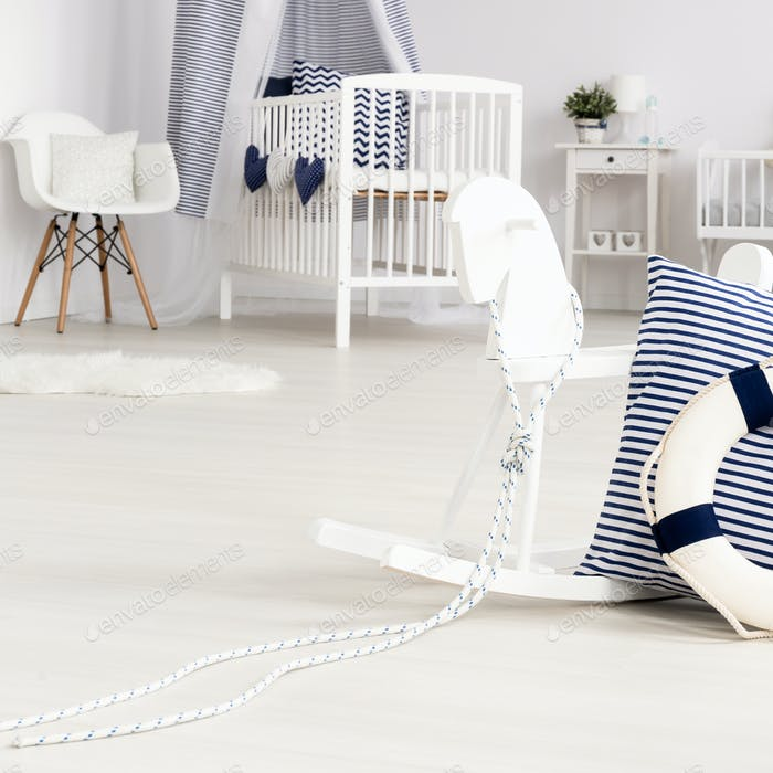 Minimalist baby room with navy accents