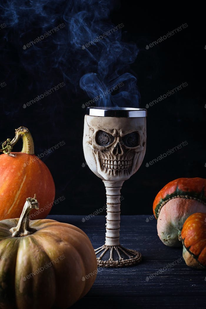 Glass in the shape a skull with Halloween drink