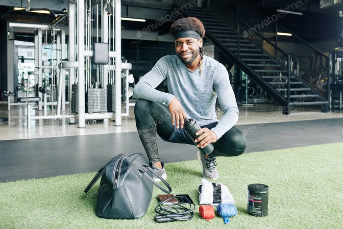 Fitness trainer with his gym bag