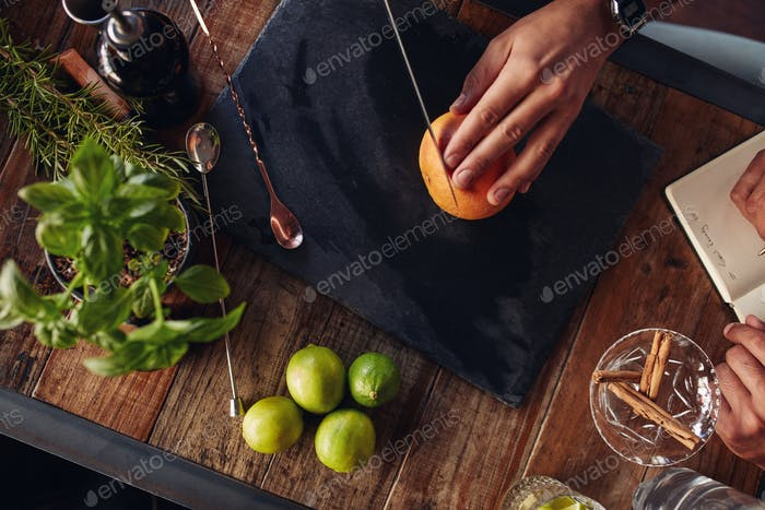 Cutting grapefruit on cutting board