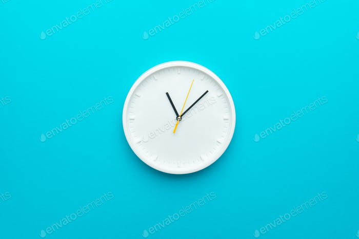 White Wall Clock On Blue Turquiose Background As Time Is Going Concept