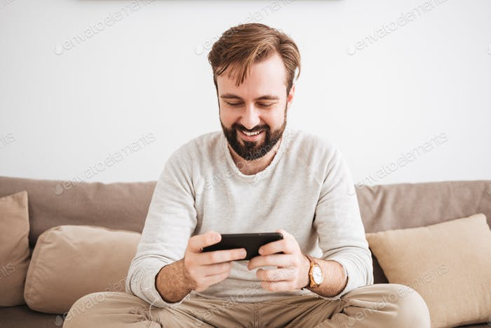 Portrait of a happy man playing games