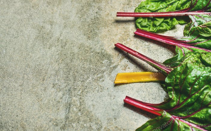 Flat-lay of fresh leaves of swiss chard, copy space