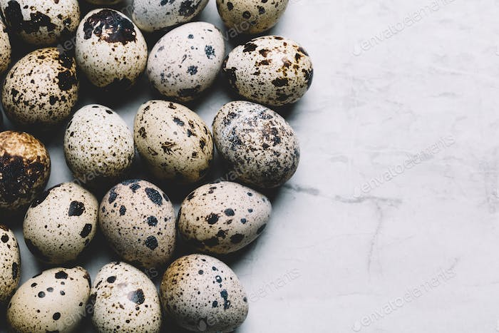 Group of quail eggs on a marble background