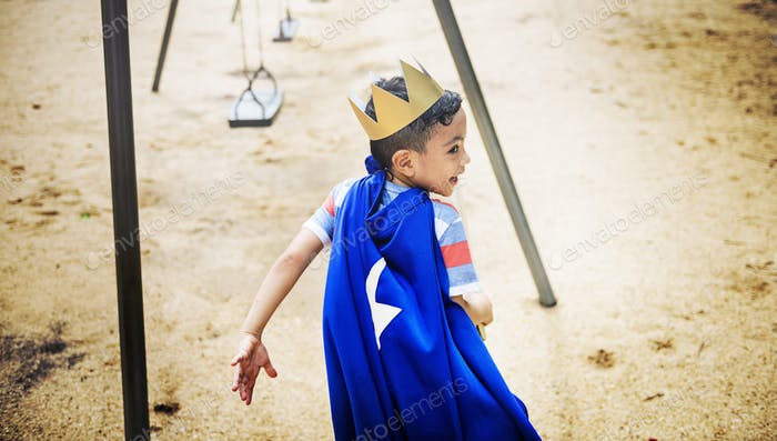 Young Boy Superhero Costume Playground Concept
