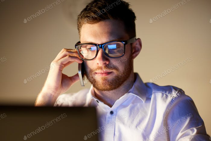 businessman calling on smartphone at night office