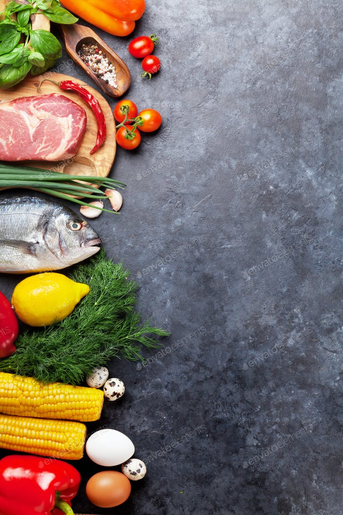 Vegetables, fish, meat and ingredients cooking