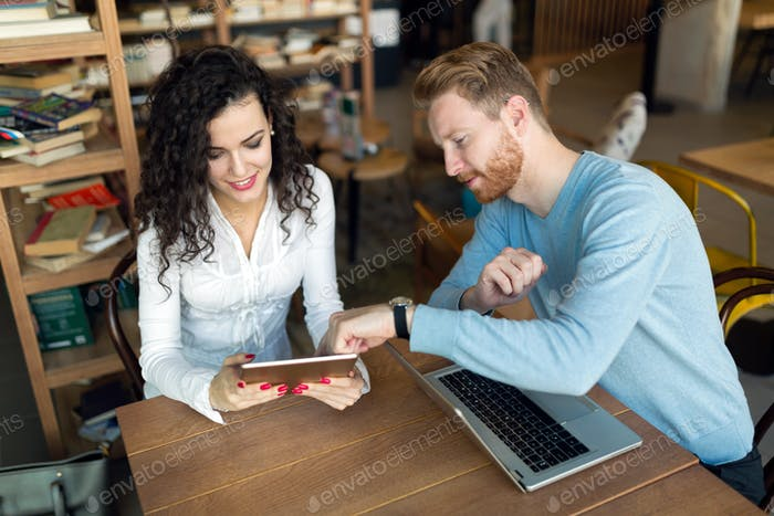 Young couple spending time together in bookstore