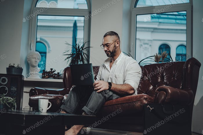 Concentrated on work caucasian man working in living room