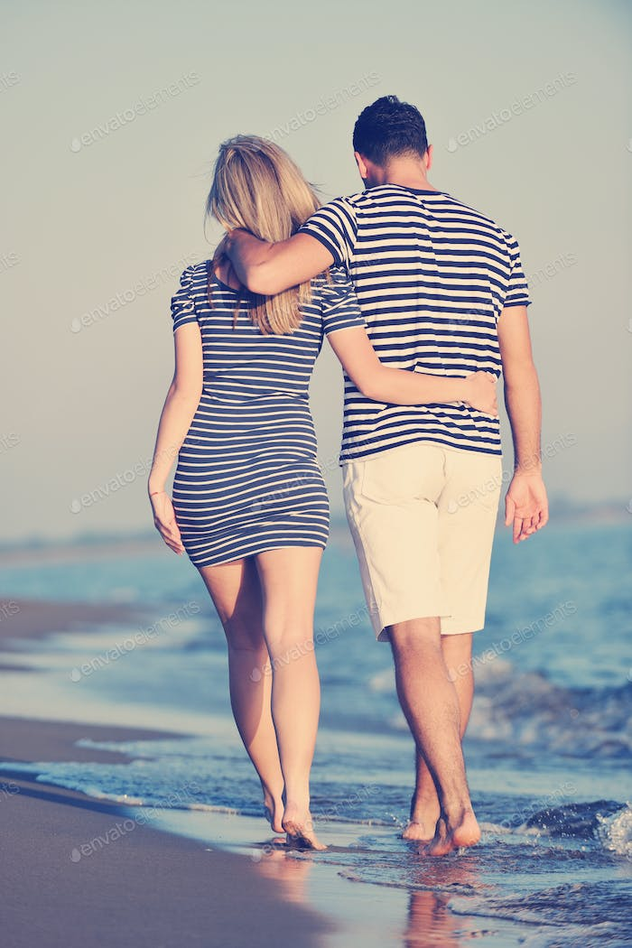 happy young couple have romantic time on beach