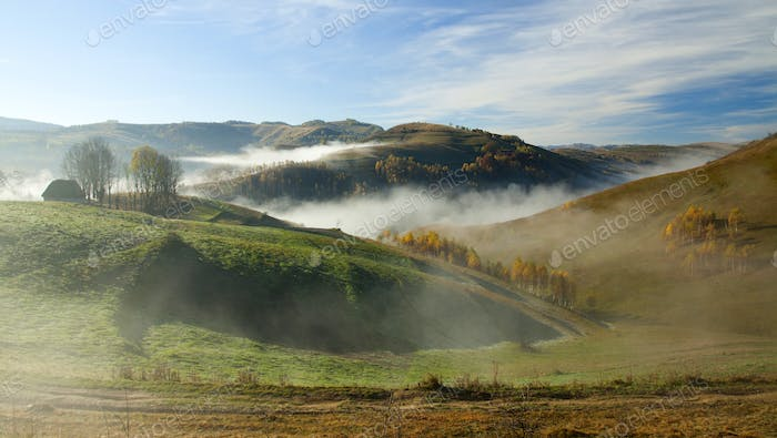 Autumn in the mountains - rural foggy landscape of high hills