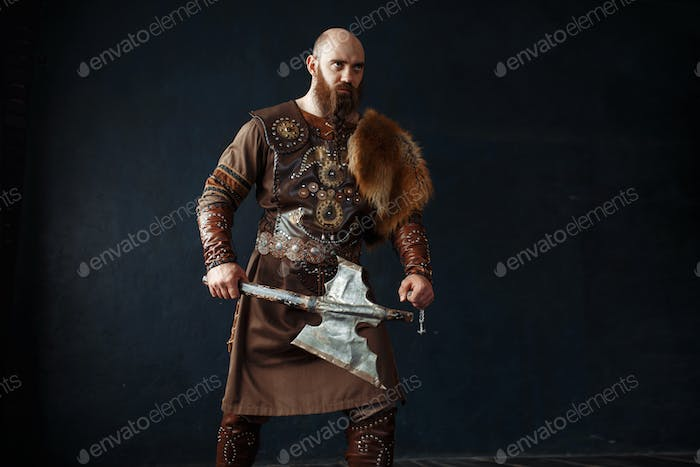 Viking with axe in traditional nordic clothes