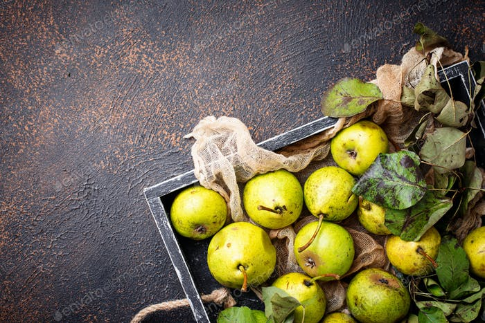 Fresh sweet organic pears in wooden box