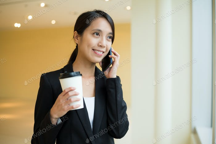 Asian Businesswoman talk to mobile phone and talk to cellphone