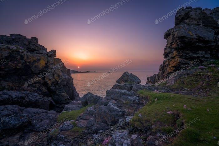 Sonnenuntergang über der Küste von Cornwall