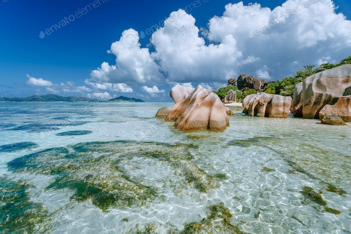 Anse Source d'Argent in low tide - Paradise tropical beach with shallow blue lagoon, granite