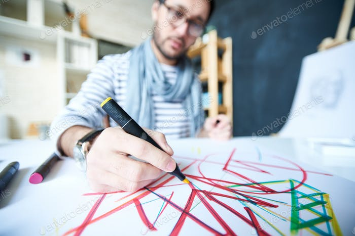 Close-up of man drawing abstraction