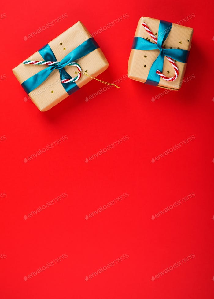 Gift box with green ribbon on red bold color