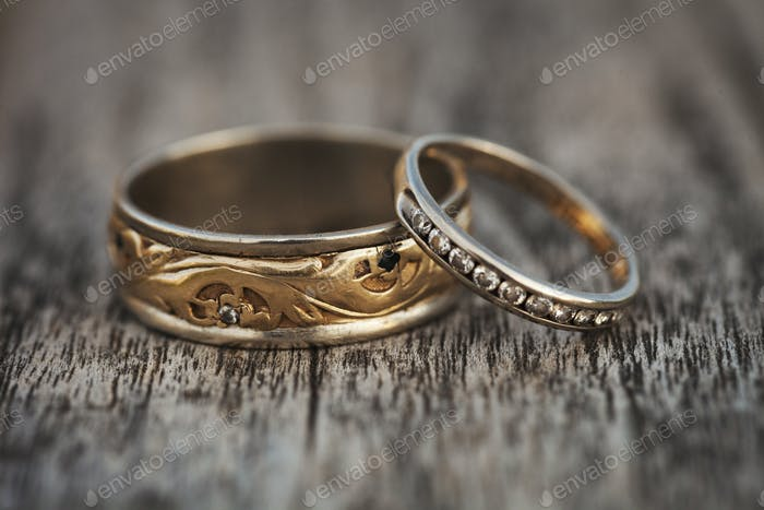 Close up of golden wedding bands.