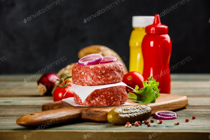 Homemade hamburgers on wooden table