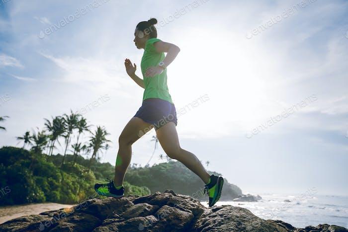 Running woman on seaside