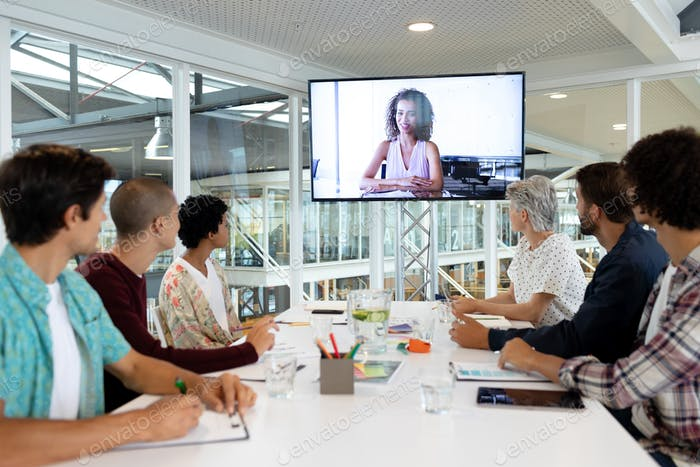 Diverse business people attending video conference
