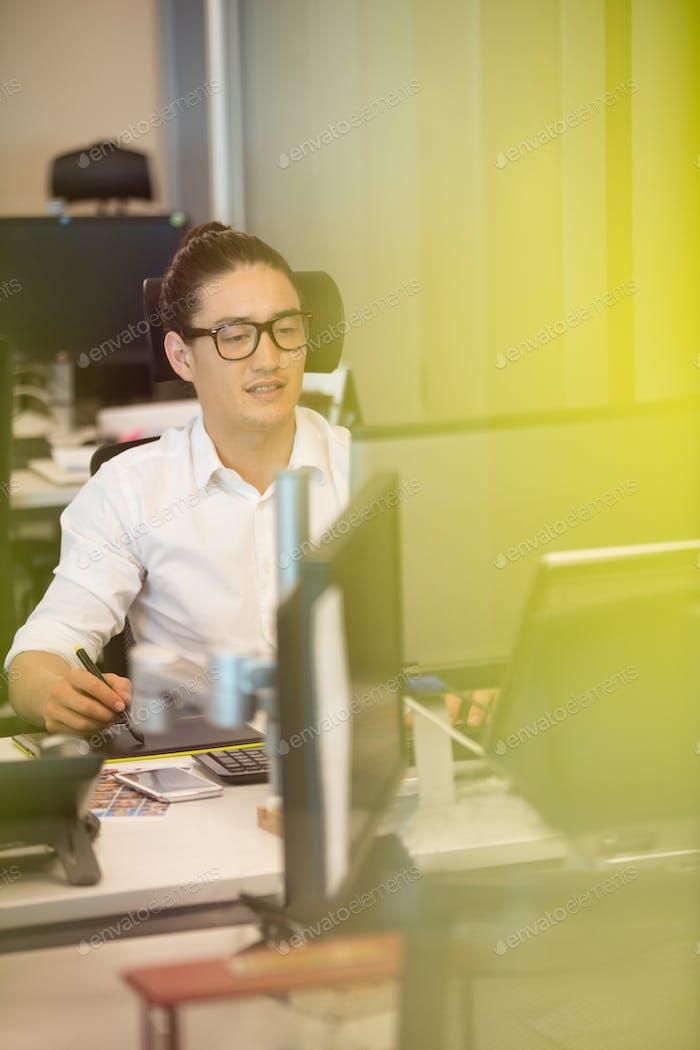 Designer using digitizer on office desk
