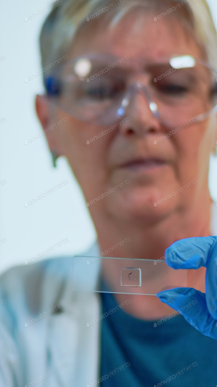 Close up of lab engineer analysing virus sample