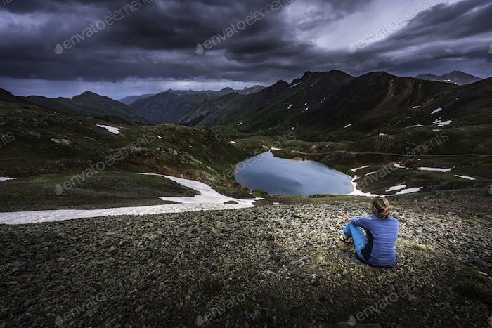 Tourist admires view from Hurricane Pass towards lake Como and P