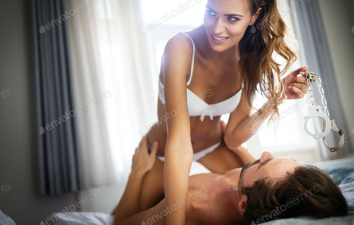 Passionate couple is having sex in a bedroom. Portrait of passion, pleasure, sex, relationship