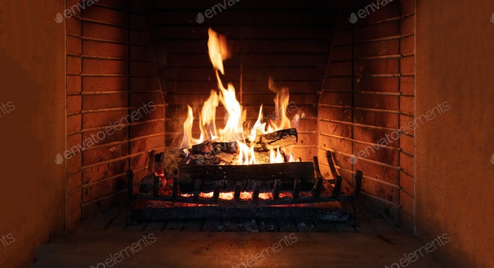 Fireplace, fire burning, cozy warm fireside, christmas home.