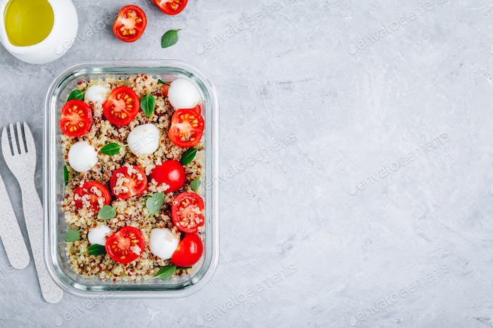 Vegetarian meal prep lunch box containers with quinoa, mozzarella cheese, tomatoes and basil.