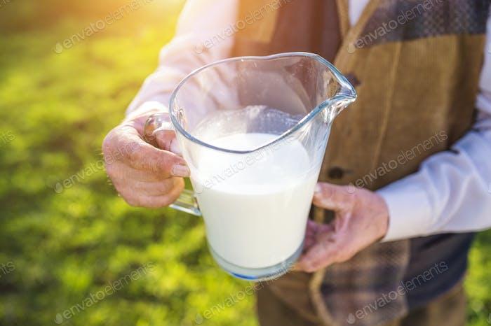 Farmer with milk jug