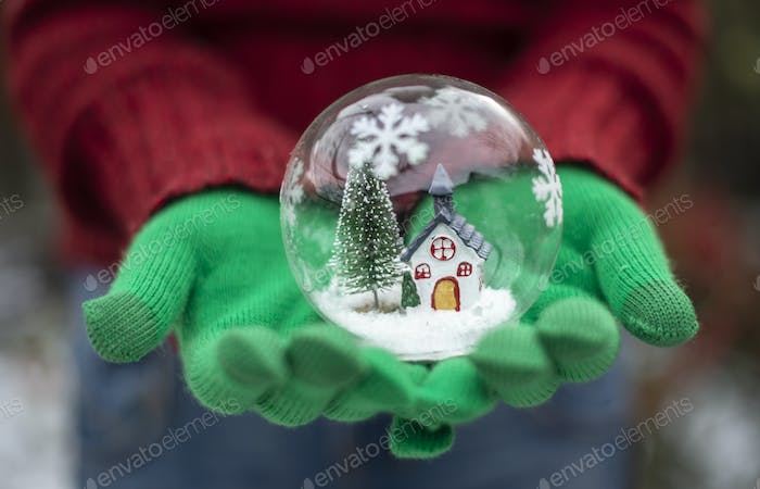 Crystal christmas ball with house and snow inside.