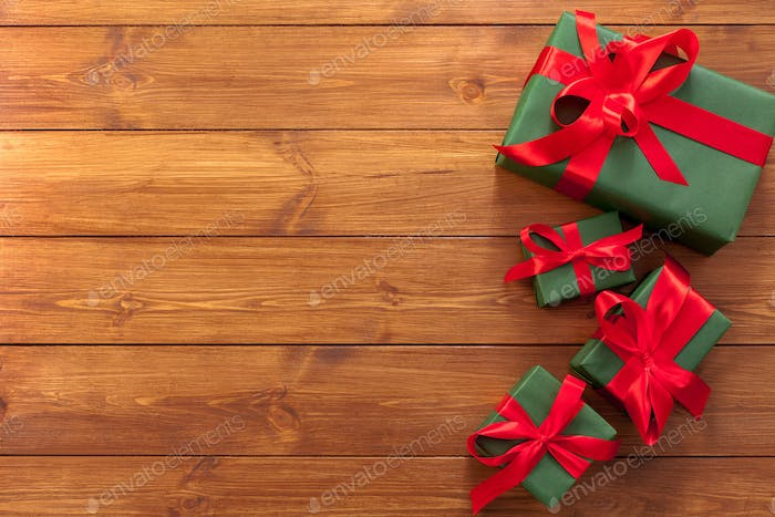 Presents in gift boxes on wood background with copy space