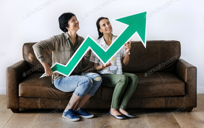Women sitting on couch and holding statistics icon