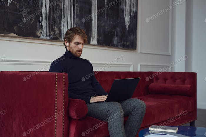 Handsome Contemporary Businessman Working in Cafe