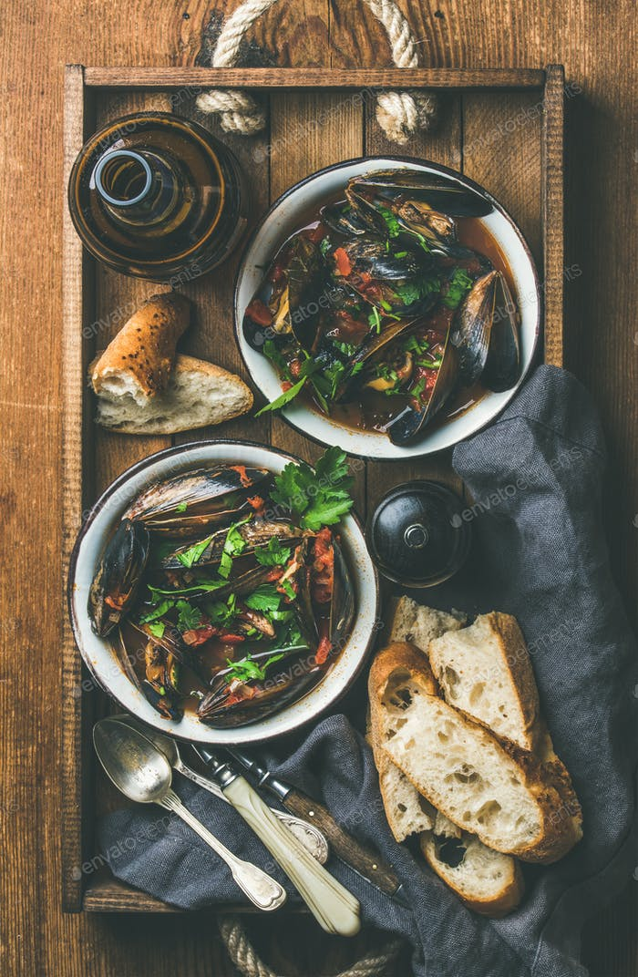 Flat-lay of Belgian boiled mussels in tomato sauce and beer
