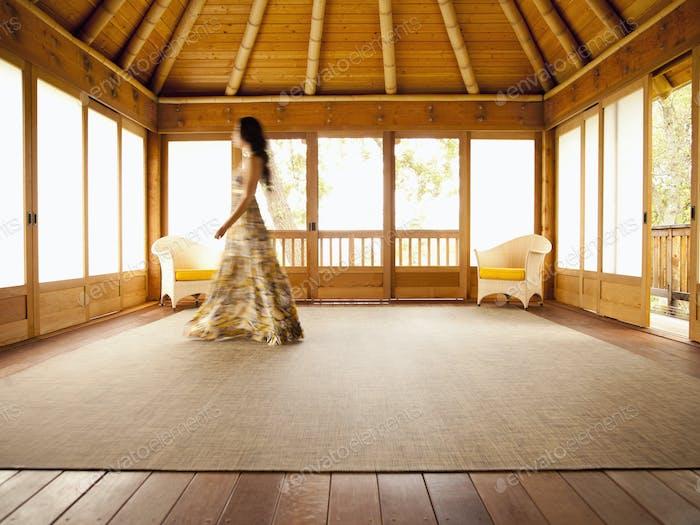 Asian woman walking in empty retreat