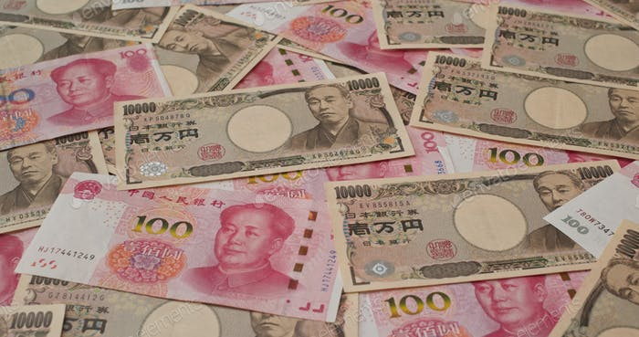 Stack of Chinese banknote and Japanese Yen