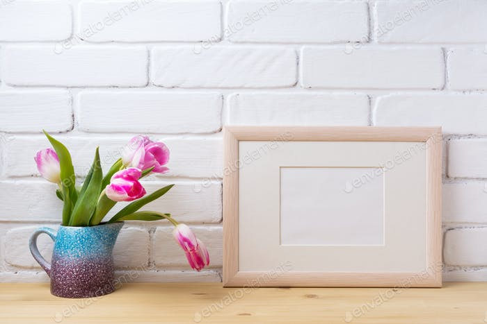 Wooden landscape frame mockup with pink tulip in purple pitcher