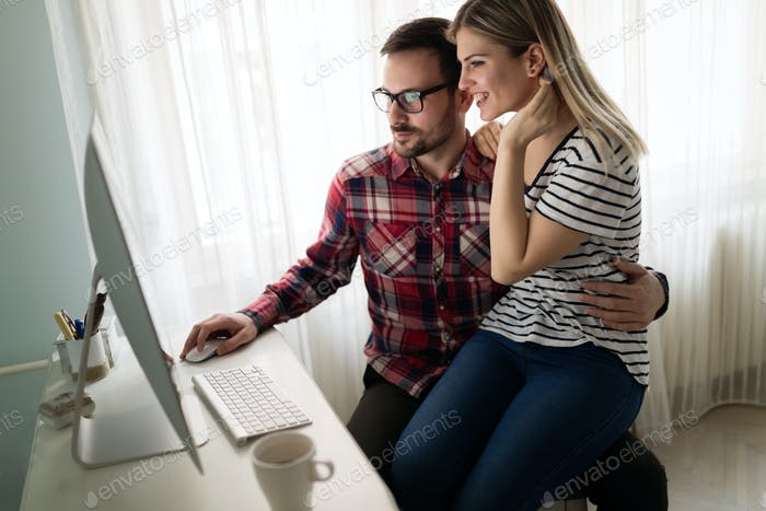 Young attractive designers working together from home
