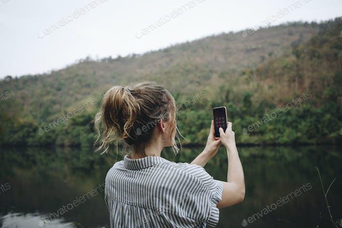 Closeup of a woman hand raising her smartphone