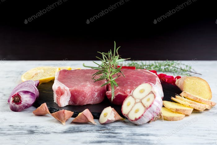Raw pork meat with spice ingredient
