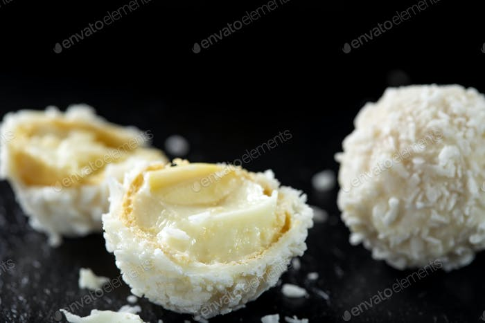 broken white candy with coconut flakes