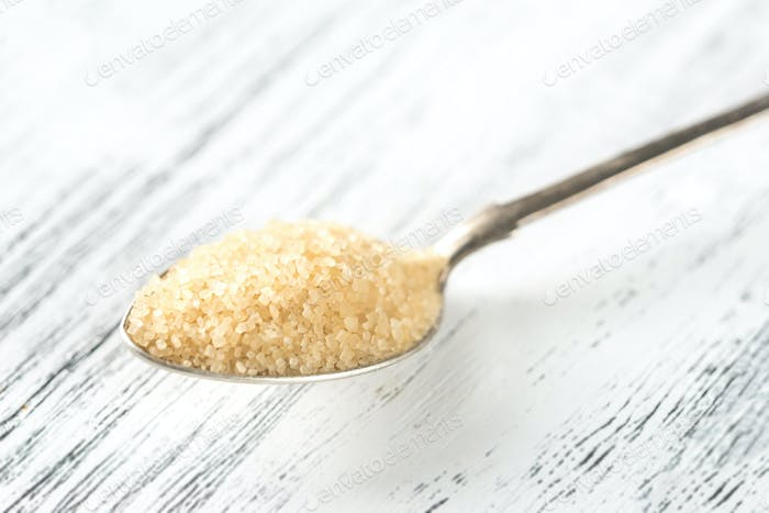 Spoon of brown sugar