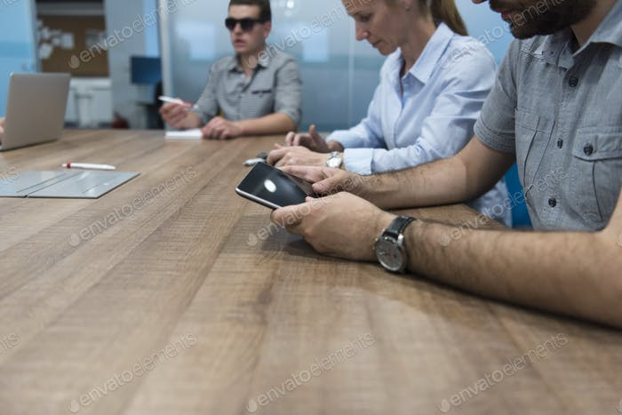 close up of  businessman hands  using tablet on meeting