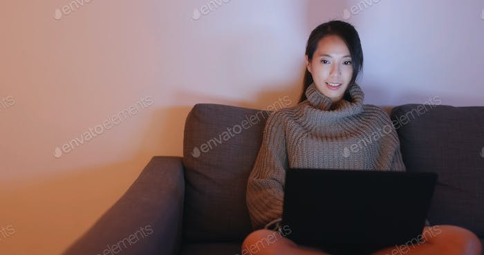 Woman look at notebook computer at home