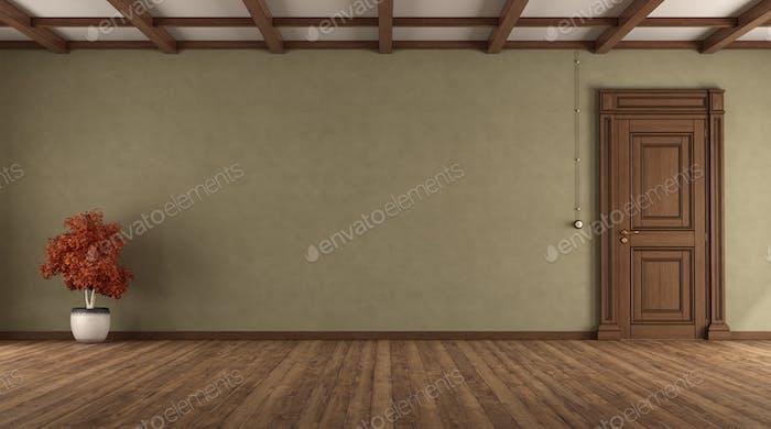 Empty retro room with closed door