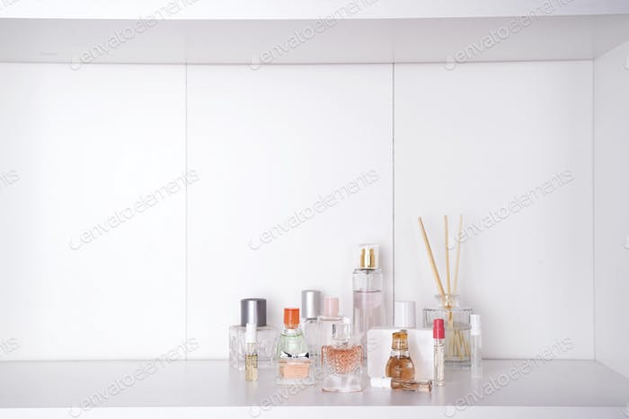 Set of various woman perfumes isolated o white background.